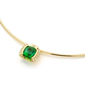Green tourmaline in gold pendant